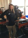 Kate Stratemeier shows off Husqvarna's MS 360G masonry saw.