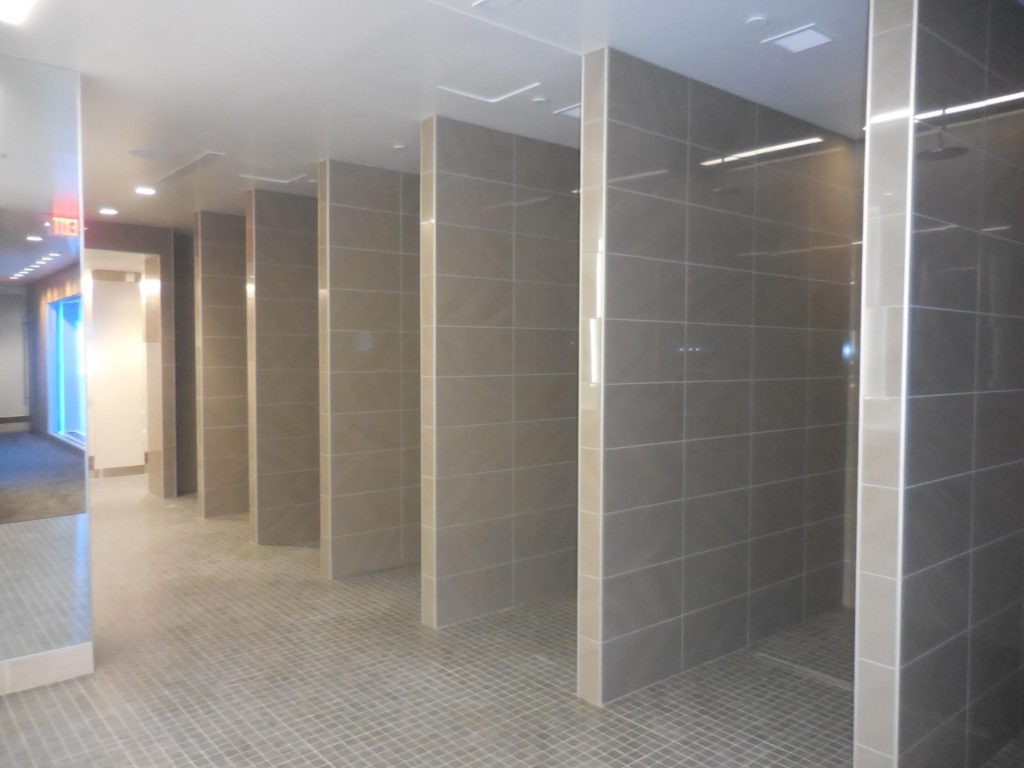 The locker room showers are ready for continuous use with LATICRETE HYDRO BAN, 4-XLT mortar and SPECTRALOCK PRO Grout on floors with PERMACOLOR Select Grout on the walls. Photo by Neuse Tile Service
