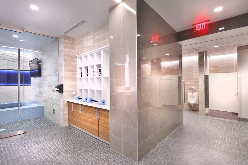 The mosaic floor tiles and large-format wall tiles properly installed with LATICRETE 4-XLT mortar over HYDRO BAN will serve the team for many years to come. All floors were grouted with SPECTRALOCK, and walls with PERMACOLOR Select. Photo by Jim Sink Photography