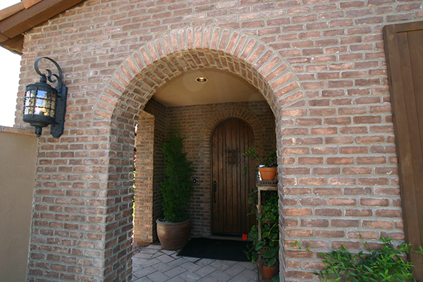 Adding brick veneer around an arched alcove