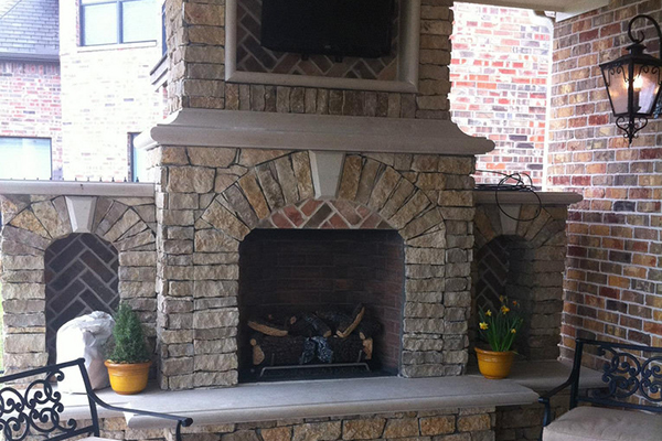 Installing brick veneer around a fireplace