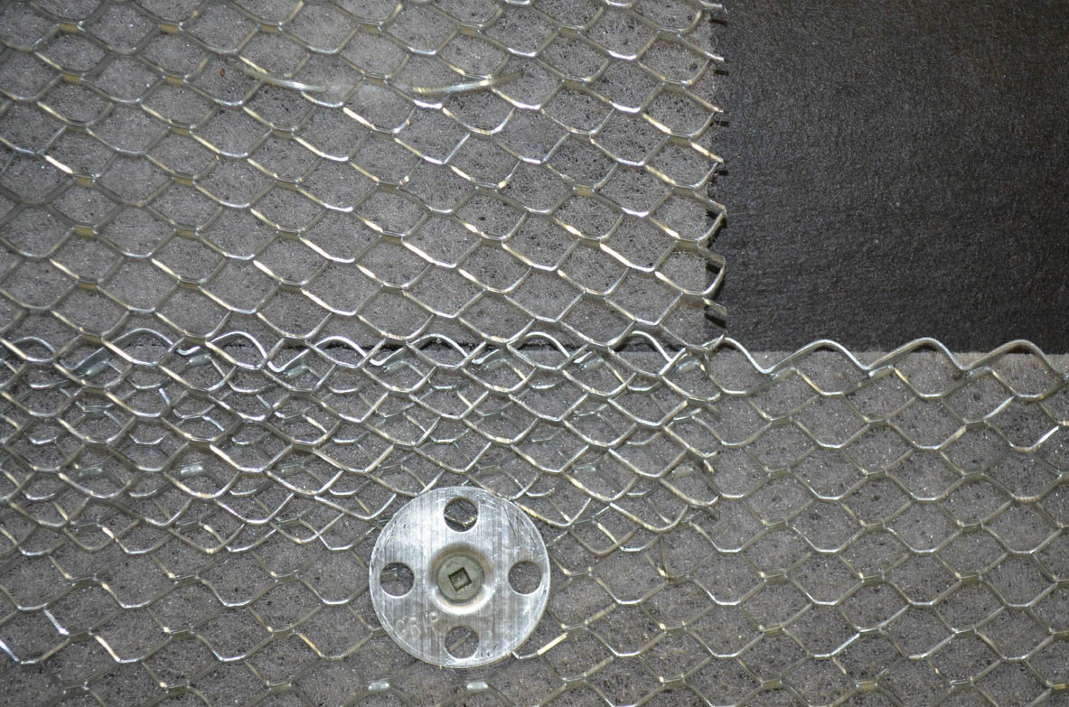 A lath washer and screw that securely attaches the lath and drainage mesh to the substrate is shown.